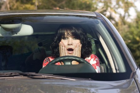 Photo for Scared young woman in a car - Royalty Free Image