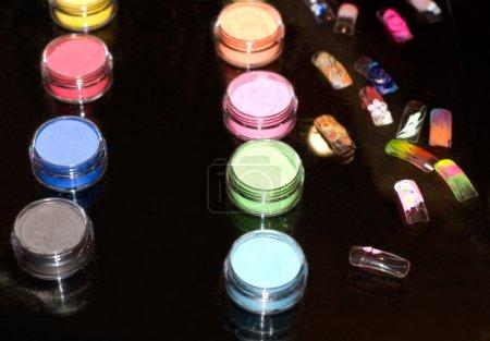 Set of powder cosmetic and fake nails