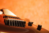 Close-up of the black electric guitar