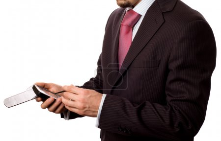 Businessman tapping on a pad computer