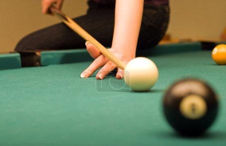 Billiard game (hand in focus)