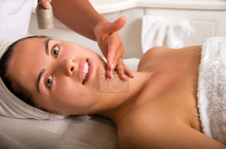 Young woman getting skin cleaning
