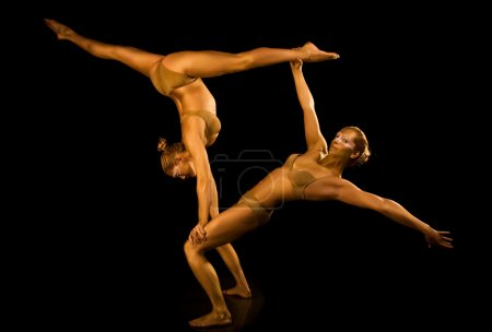 Photo for Two acrobatic girl toned in gold - Royalty Free Image