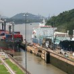 Big ships entering Panama Canal at Miraflores lock...