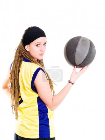 Young woman playing game with basketball