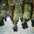Soldiers march in formation...