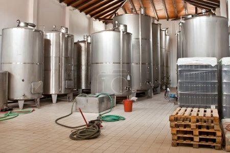 Wine Fermenting in huge vats in a wine cellar