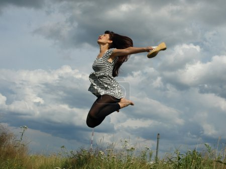 Very happy woman jumping pleasure odes