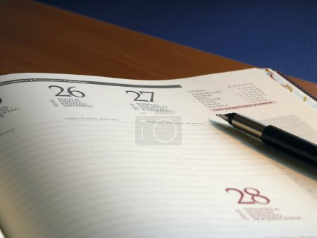 Calendar with pen on top