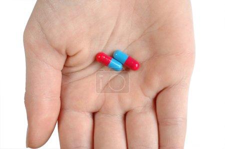 Photo pour Main et capsules - image libre de droit