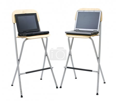 Open standing on bar stools two laptops