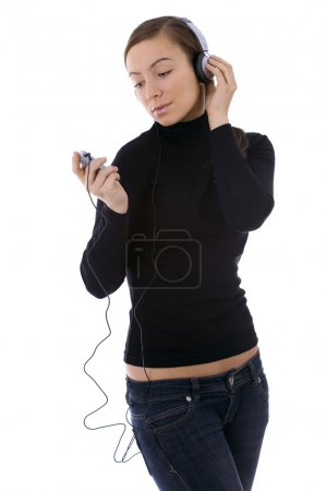 Young woman listening mp3 player
