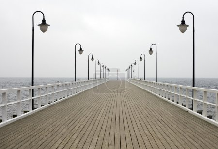 Wooden pier on the sea with lanthorns