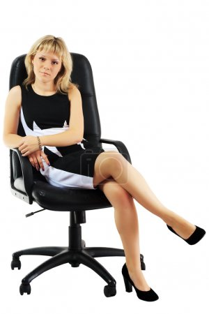 The woman sits on office armchair