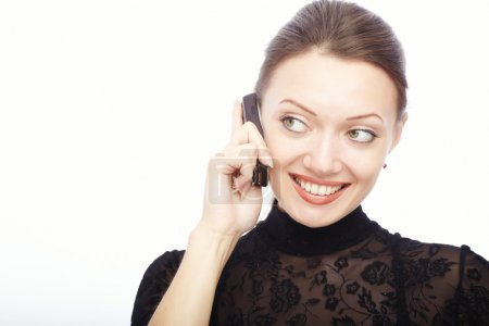 Photo for Glad smiling lady on a white background talking via cellphone - Royalty Free Image