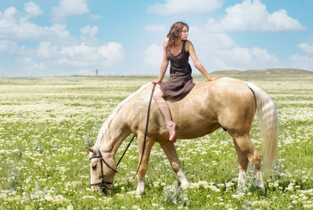 Small woman on a big horse