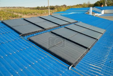 Solar water heating system on the house roof....