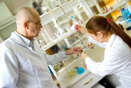 Professor and assistant in laboratory
