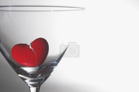 Photo for A broken heart drowning in a martini glass. - Royalty Free Image