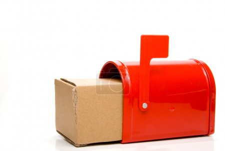 Photo for A parcel package box in a mailbox. - Royalty Free Image
