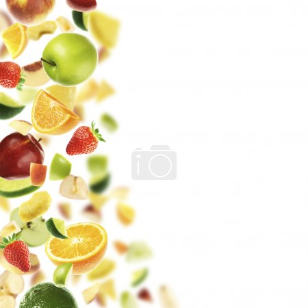 Photo for Different falling fruits. White copyspace on the right - Royalty Free Image