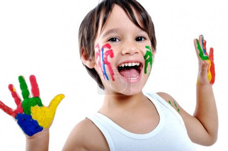 Photo for Five year old boy with hands painted in colorful paints ready for hand prints - Royalty Free Image
