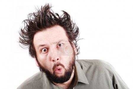 Photo pour Fou jeune homme d'affaires expression faciale - image libre de droit