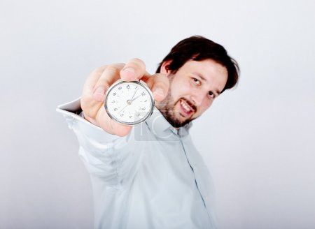 Young man with clock or watch in his hand