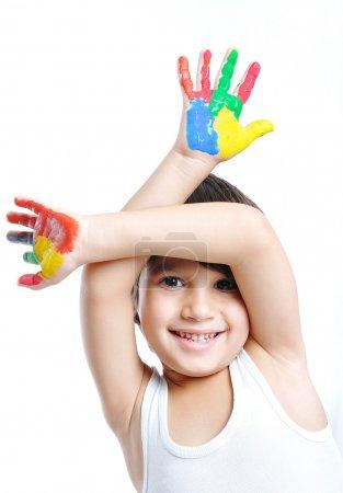 Foto de Un niño lindo con colores en blanco - Imagen libre de derechos
