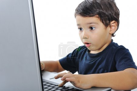 A little cute kid with a laptop isolated
