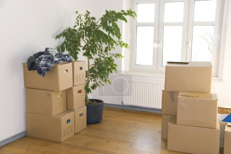 Photo for Many stacked moving boxes in a room - Royalty Free Image
