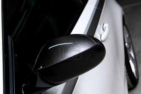 New white car on black background
