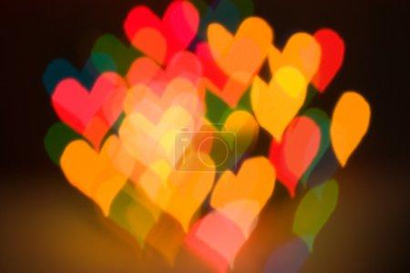 Photo pour Effet flou abstrait les lumières chaudes en forme de cœur - image libre de droit