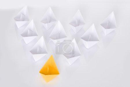 Winning yellow paper boat origami