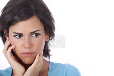 Portrait of beautiful woman is worried