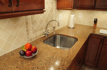 Steel sink in a remodeled kitchen