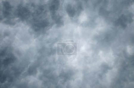 Dark clouds lighter toward center