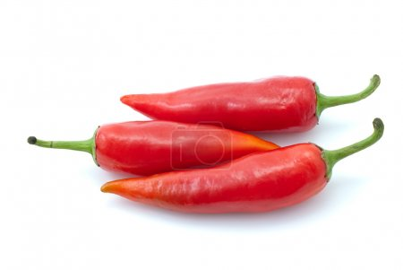 Photo for Three red chili peppers isolated on the white background - Royalty Free Image