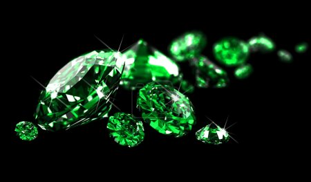 Emeralds on black surface