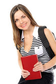 Beautiful girl with a backpack, book