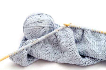 Wool ball and knitting white bamboo need