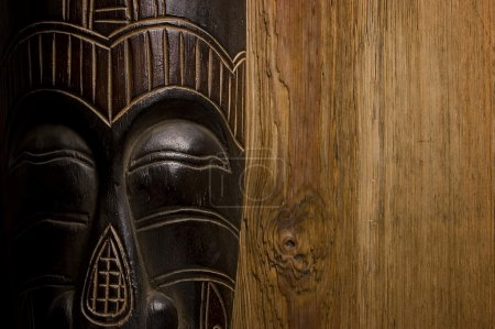 African mask over wooden background
