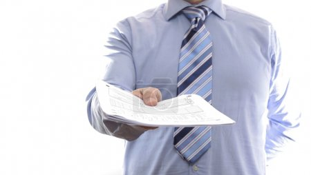 Businessman handing documents.