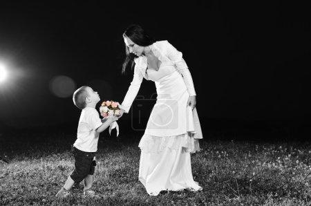 Bride giving child flower