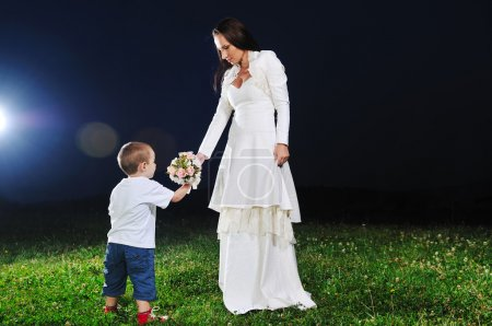 Bride giving child flower