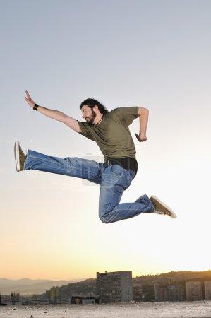 Man jumping outdoor sunset