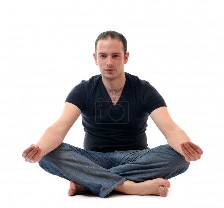 Young man in lotus position exercising yoga