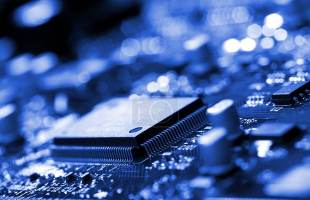 Photo for Close-up microchip on circuit board, blue toning - Royalty Free Image