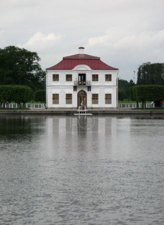 Pond and white house in park