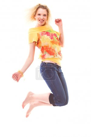 Photo pour Fille sautant de joie sur blanc - image libre de droit